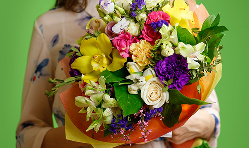 Woman holding colorful flowers - Tunie's Floral Expressions