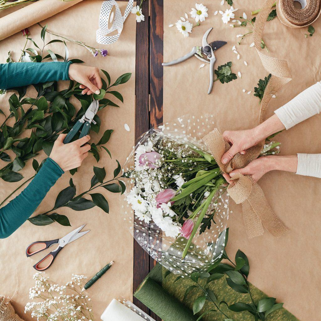 Tunie's Floral Expressions - Woman Preparing Floral Arrangements